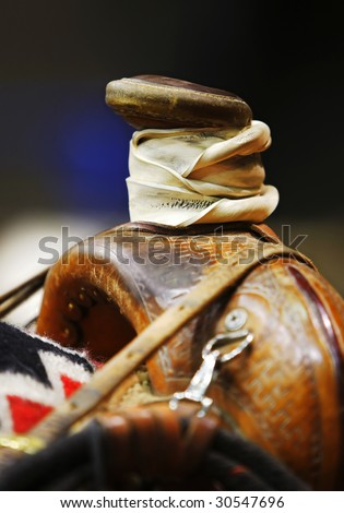 Closeup of the saddle horn of a well-used western roping saddle on a horse (shallow focus point on horn) - stock photo