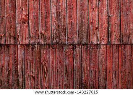 Closeup of the side of a weathered red barn, Stowe, Vermont, USA - stock photo