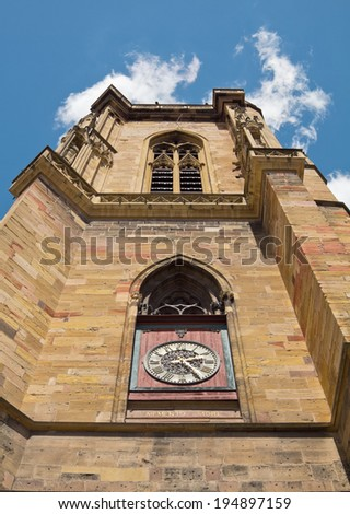 Closeup of the St. Martin church with the clock - stock photo