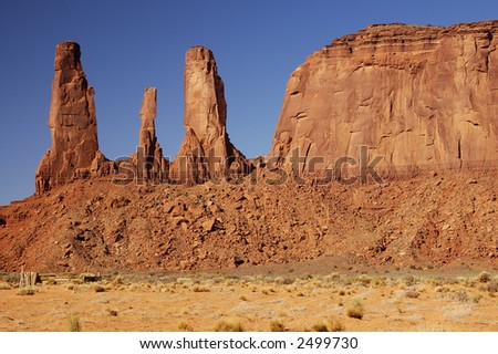 Closeup of the Three Sisters mesa in Monument Valley, Navajo Nation. - stock photo