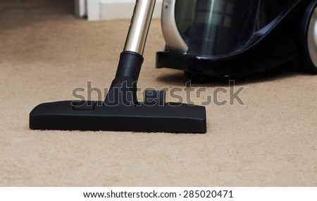 closeup of the vacuum on the carpet