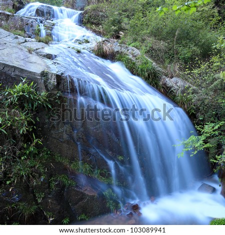 closeup of the waterfall on the rock ,natural environment - stock photo