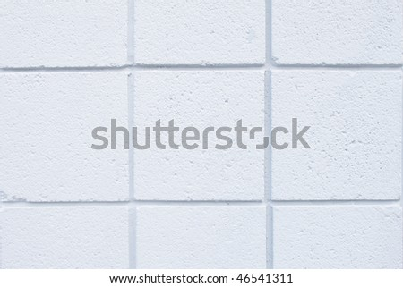 Closeup of the white tiled wall of a house - stock photo