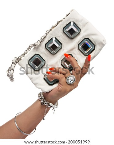 closeup of the woman??s hand wearing luxury ring, orange nail art manicure with white leather bag with silver chain bag, isolated on white studio background  - stock photo