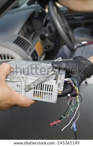 Closeup of theft of car radio - stock photo