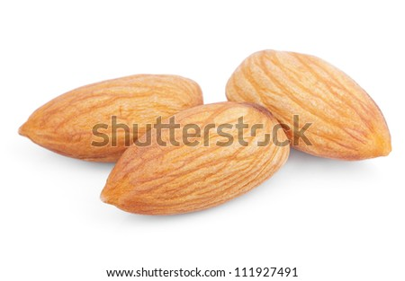 Closeup of three almond nuts isolated on white - stock photo
