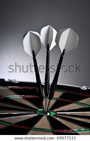 Closeup Of Three Arrows In The Middle Of The Target - stock photo