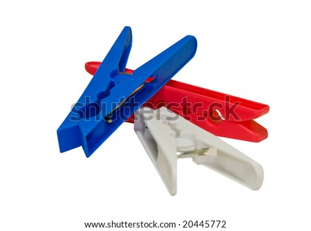 Closeup of three different colored clothes pegs - stock photo