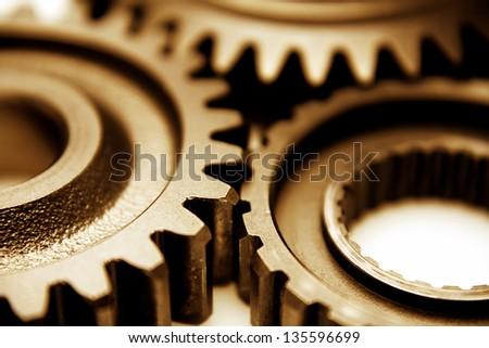 Closeup of three metal cog gears - stock photo
