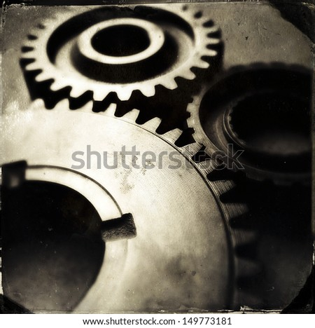 Closeup of three metal gears - stock photo