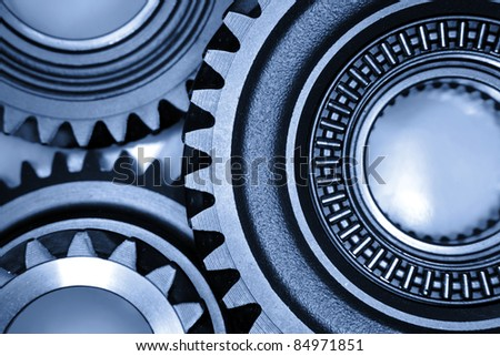Closeup of three metal gears - stock photo
