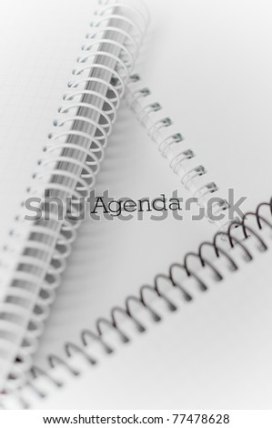 "Closeup of three notebooks with word ""Agenda"""