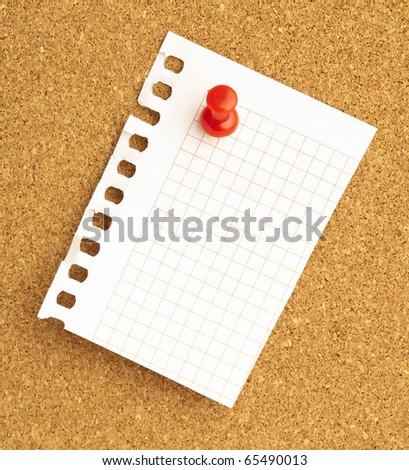 closeup of thumbtacks and notes on cork - stock photo
