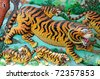 Closeup of Tiger on wall - stock photo