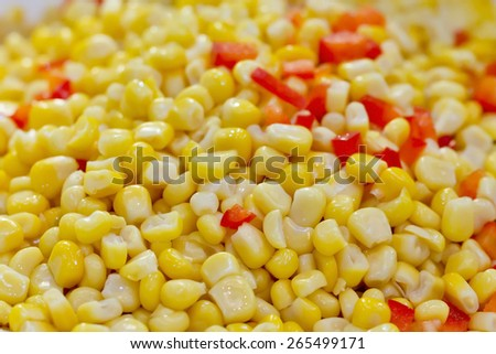 Closeup of tinned whole kernel corn and carrots, it could be used as background - stock photo