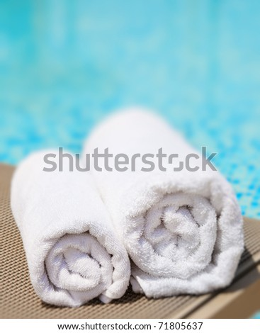 Closeup of towels at a luxury swimming pool - stock photo