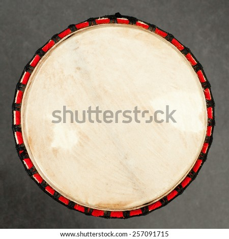closeup of traditional african drum on square picture - stock photo