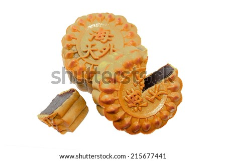 Closeup of traditional Chinese mooncake and cutout over white background.  (The chinese words indicates the type of mooncake, not the brand) - stock photo