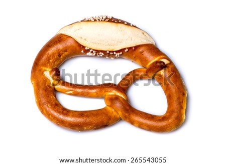 Closeup of traditional fresh German pretzel (Bretzel) with salt on white background - stock photo