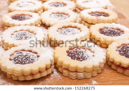 Closeup of Traditional Linzer Cookies on Wooden Board - stock photo