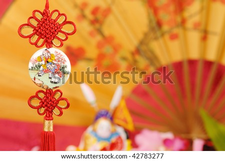Closeup of traditional lucky knot with festive background. - stock photo