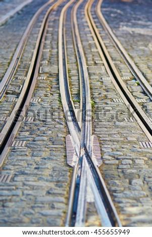 Closeup of tram rails in Lisbon, Portugal - stock photo