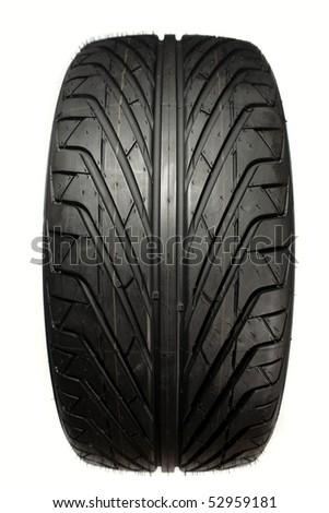 Closeup of tread pattern. Auto tyre isolated on plain background - stock photo