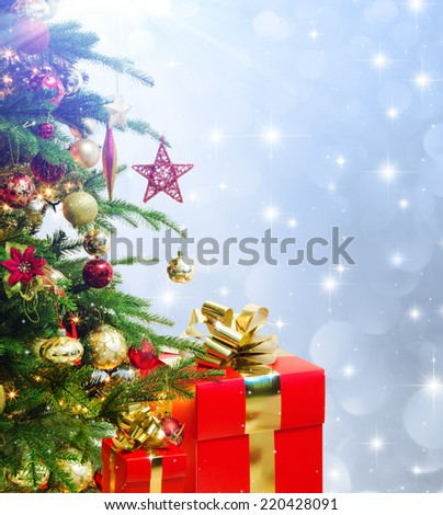 closeup of tree christmas decorated with christmas red presents - stock photo