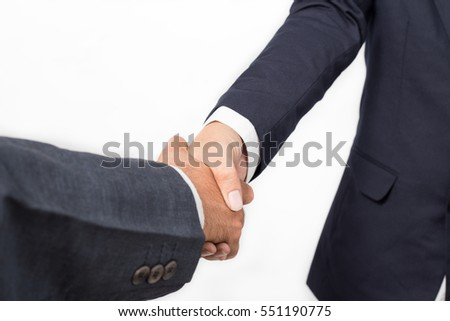 Closeup of two business handshake  isolated on white background