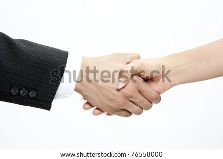 Closeup of two business men shaking hands on a deal - stock photo