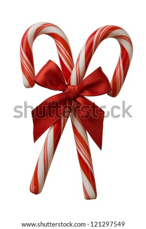 Closeup of two candy canes with red bow isolated on white.