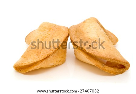 Closeup of two Chinese fortune cookies on a white background - stock photo