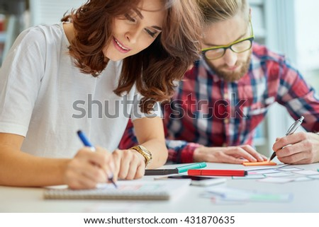 Closeup of two designers working on new web site project - stock photo