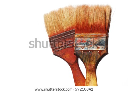 closeup of two dirty paintbrushes against white background - stock photo
