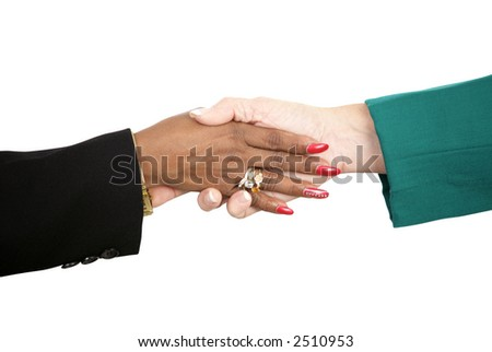 Closeup of two diverse female business people shaking hands.  Isolated on white with clipping path. - stock photo