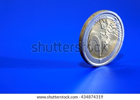 Closeup of two Euro coin on blue background with free space for text