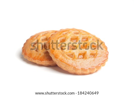 Closeup of two freshly baked homemade tarts, isolated over white
