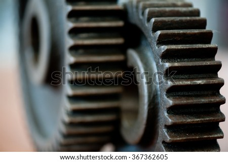 Closeup of two gearing, cogs