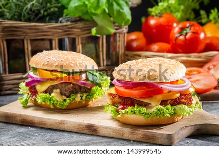 Closeup of two homemade hamburgers - stock photo