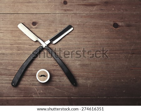 Closeup of two razors and wax box - stock photo