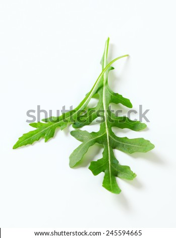Closeup of two rocket leaves - stock photo