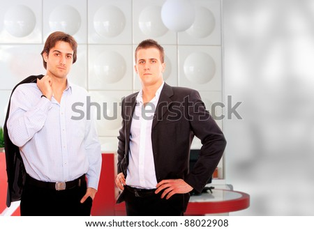 Closeup of two standing in a light and mordern business environement