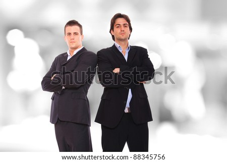 Closeup of two standing in a light and mordern business environement - stock photo