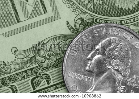 Closeup of U.S. money: a quarter and a dollar bill - stock photo