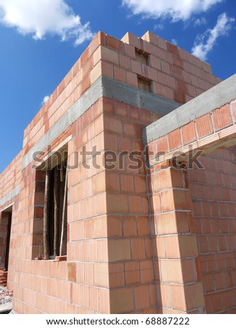 Closeup of unfinished family house made of bricks - stock photo