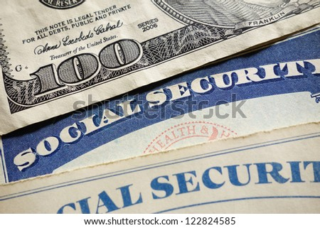 Closeup of US Social Security cards and money