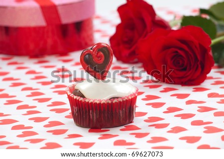 Closeup of Valentine day chocolate cupcakes garnished with heart shaped chocolates.