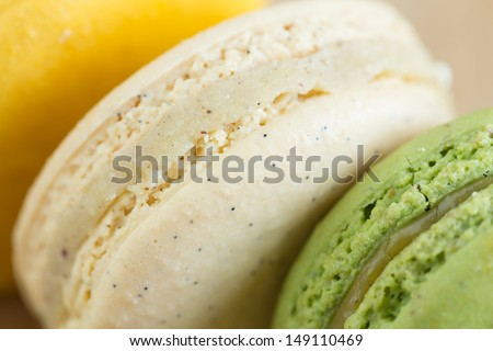 Closeup of vanilla and pistachio french macaroons