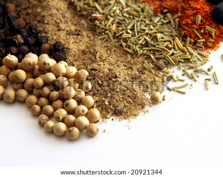 closeup of various colorful spices over white - stock photo