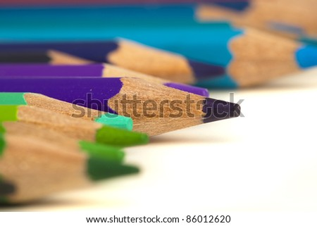 closeup of various crayons on a white background - stock photo
